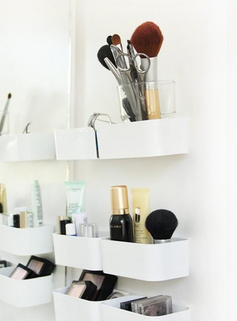an Ikea Pluggis system is used to create a perfect makeup storage station for a bathroom or some other space