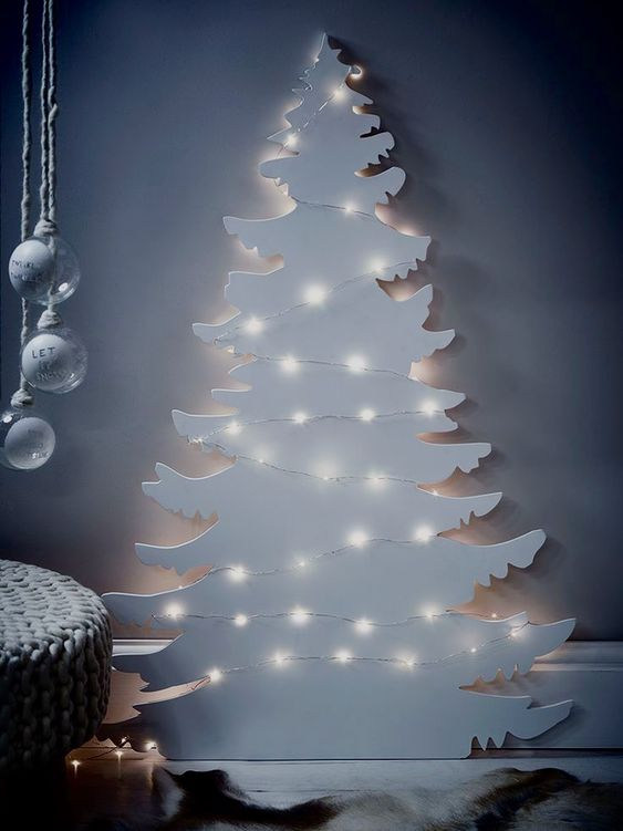 a white plywood Christmas tree with lights is a beautiful and very cool idea for a modern space, it won't take much space