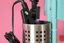 24 an IKEA utensil holder used for storing a curling iron and straightener – great to store your hot tools in it