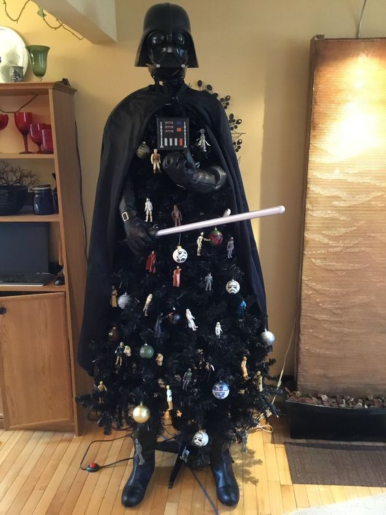 a unique black Darth Vader Christmas tree with ornaments themed as Star Wars is a lovely and bold idea to rock