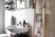 25 an Ivar side unit can be used as a ladder for a sleek storage unit in your bathroom, it's modern and fresh