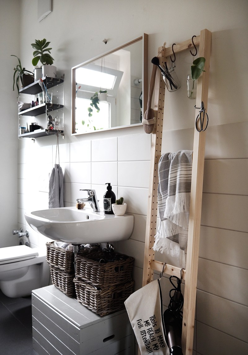 an Ivar side unit can be used as a ladder for a sleek storage unit in your bathroom, it's modern and fresh