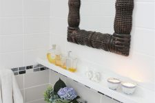 26 IKEA's slender picture ledges used to add some storage over the sink, a genius idea for a small bathroom like this one