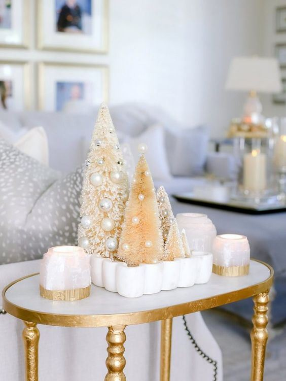 lovely Christmas decor with candles, bottle cleaner Christmas trees with pearls and beads as ornaments is very glam and chic