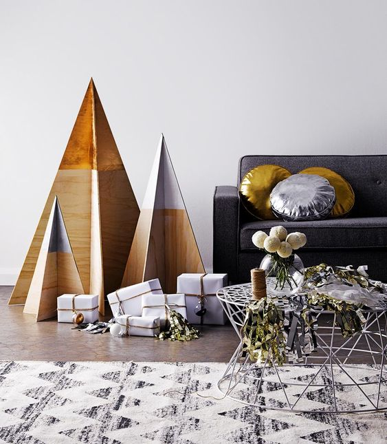 minimalist color block plywood Christmas tree and white and gold gifts are amazing for minimal and very simple holiday decor