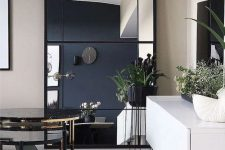 a beautiful modern statement mirror made of IKEA Morson mirrors and a wooden frame is a gorgeous idea