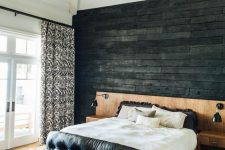 a black wall could also add coziness to a room if it's made of wood