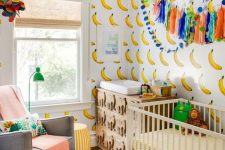a bright and fun nursery wotj banana walls, bold bedding and a rug, a catchy carved elephant dresser and simple furniture