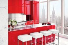 a bright minimalist red and white kitchen with sleek metal backsplashes and countertops and a row of white stools