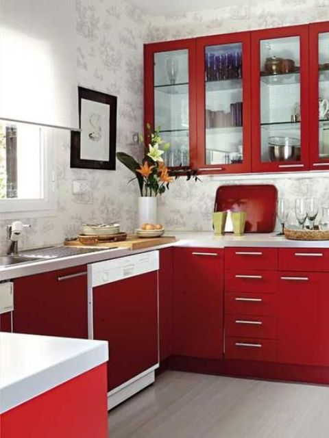 a bright modern red kitchen with wallpaper walls, white stone coutertops and simple handles plus artworks is amazing