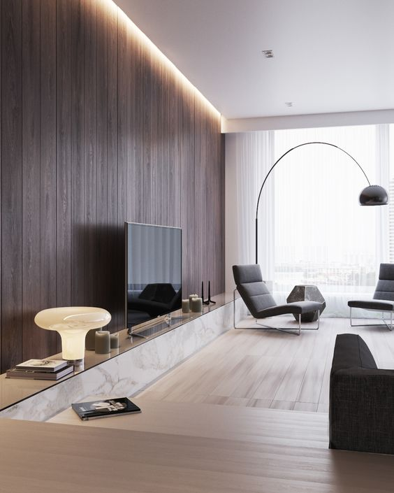 a chic modern space with light-colored wooden floors and a dark stained wooden wall with additional lights
