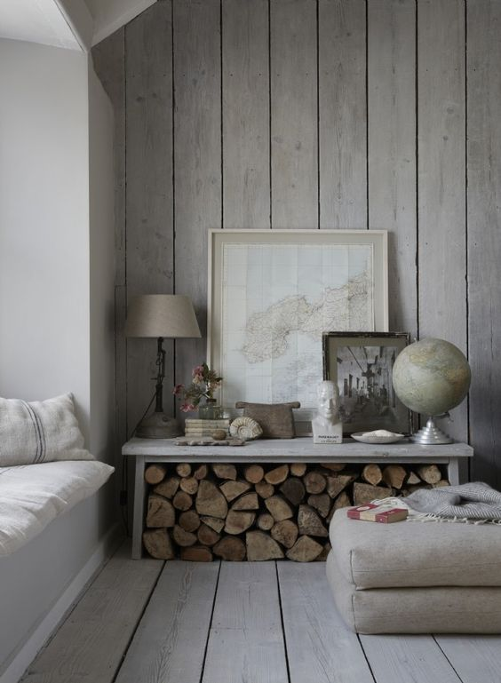 a chic whitewashed space with a wooden wall and floor looks comfy, relaxed and welcoming