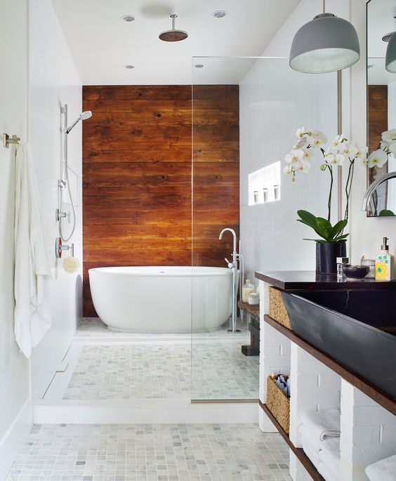 a cognac colored wood accent wall to bring a cozy and eye catching touch and contrast the neutral tiles around