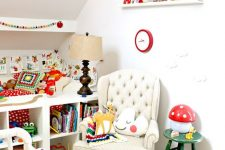 a colorful retro Scandinavian nursery with bold printed bedding, rugs, toys, books and accessories is a bold and fun palce to be
