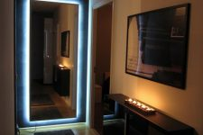a contemporary entryway with an IKEA Hovet mirror that is lit up looks fantastic and very edgy