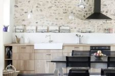 a contemporary kitchen made catchy with a whitewashed stone accent wall and neutral hex tiles on the floor