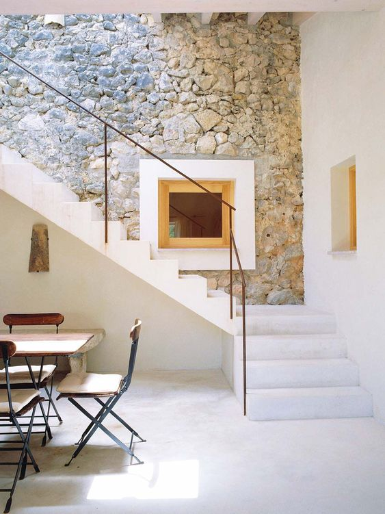 a contemporary space with a real stone accent wall   an original feature that was preserved and made outstanding