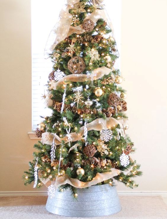 a fabulous rustic Christmas tree with burlap ribbons, vine balls, pinecones, snowflakes, lights and some stars