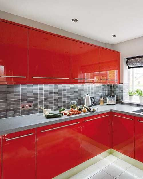 a fiery red contemporary kitchen with a concrete countertop and a pretty grey tile backsplash is a bold and cool solution