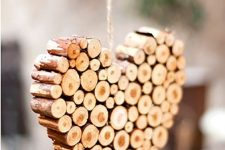 a heart Christmas ornament of wood sticks is a lovely idea for adding a slight rustic feel to the space