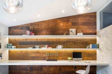 a minimalist home office with a stained wooden wall, floating shelves and a desk plus cool bubble lamps looks wow