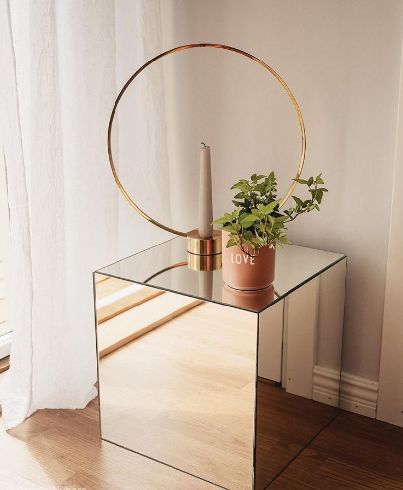 a mirror cube made of IKEA LOTS mirrors, an adhesive for metal and glass and some other stuff is a classy option