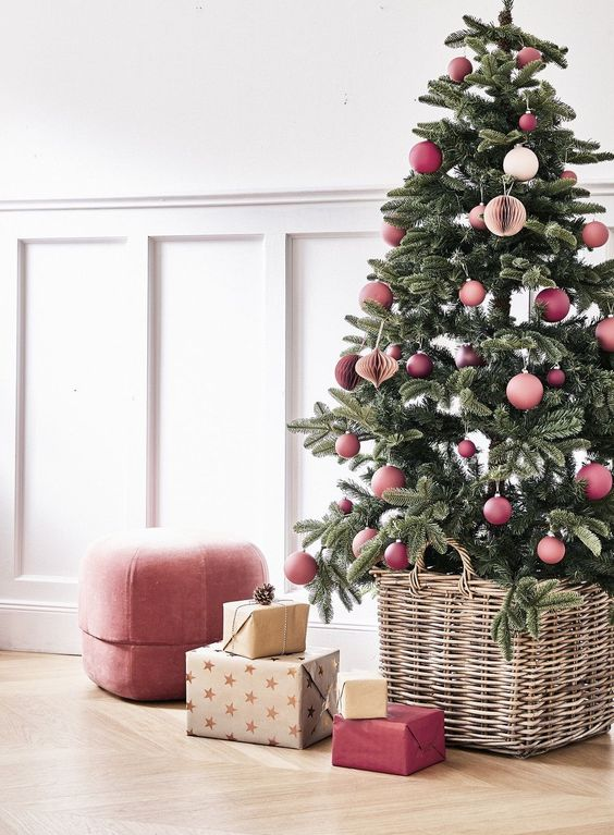 a modern and colorful Christmas tree decorated with pink and mauve ornaments, 3D paper ornaments and some matching gifts