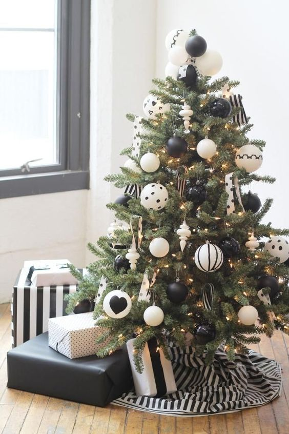 a monochromatic modern Christmas tree with black and white printed ornaments and polka dot and striped ribbons