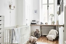 a neutral nursery with white furniture, cozy fluffy textiles, a gallery wall and shelves and much natural light coming in