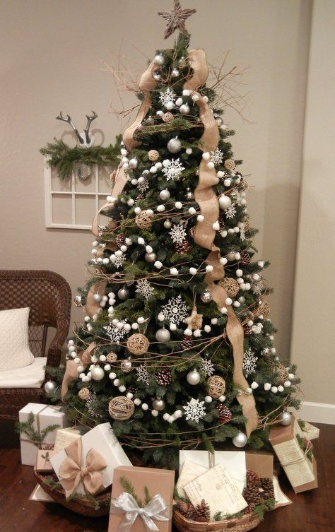 a pretty rustic Christmas tree with burlap ribbons, pompom garlands, twine balls, snowflakes and branches
