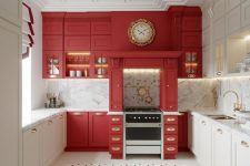 a refined kitchen with white and red cabinets, white marble surfaces and gold handles plus a tile floor just wows