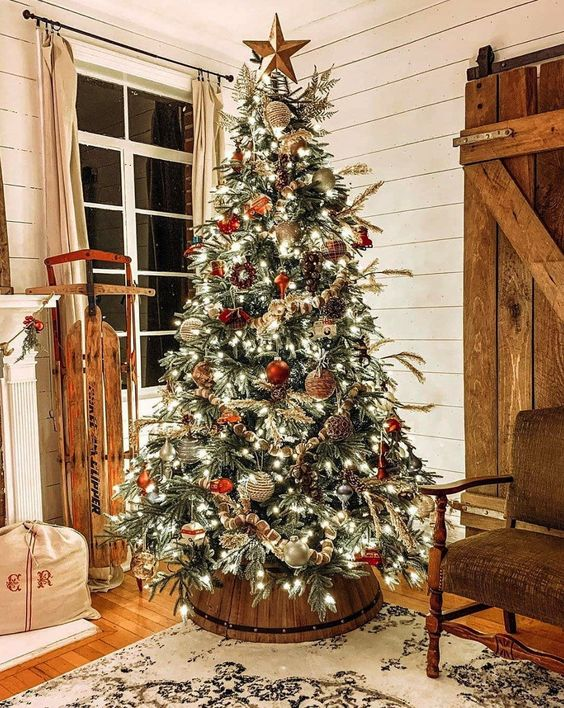 a rustic Christmas tree with lights, red and silver ornaments, pinecones, beads and plaid balls is lovely and cool