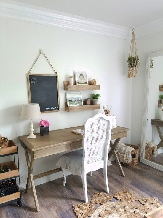 a rustic home office with a wooden trestle desk, a vintage chair, a jute rug, a basket and a wooden trolley is amazing