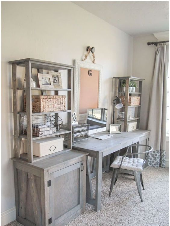 a rustic meets vintage home office with light grey furniture, a metal chair and a large note board for a chic look