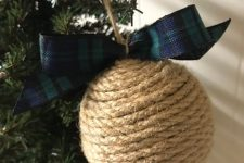 a rustic twine Christmas ornament with a plaid bow is a gorgeous idea and you can make it yourself anytime