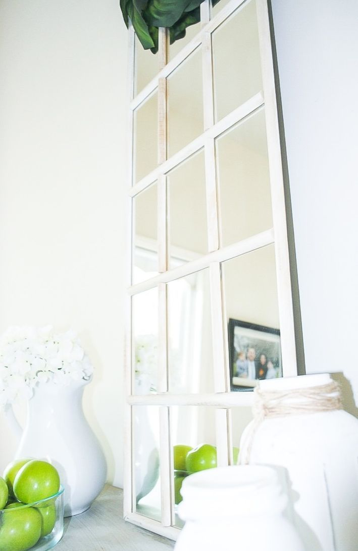a simple IKEA mirror transformed into a faux farmhouse window mirror to finish off a farmhouse space