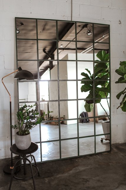 a statement industrial mirror made of IKEA LOTS mirrors is a bold idea for any space and it will fit many decor styles you might have