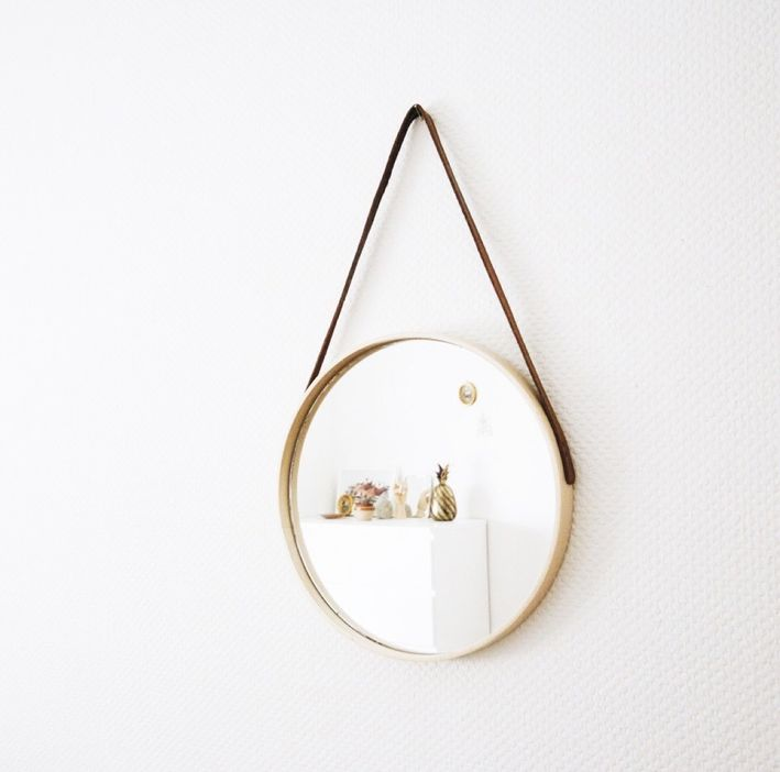 a suspended mirror made of a usual one using an IKEA tray and some leather cord is an easy idea