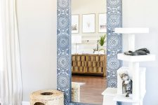 a usual IKEA mirror given a new frame that features blue and white stenciling for a chic and bold look