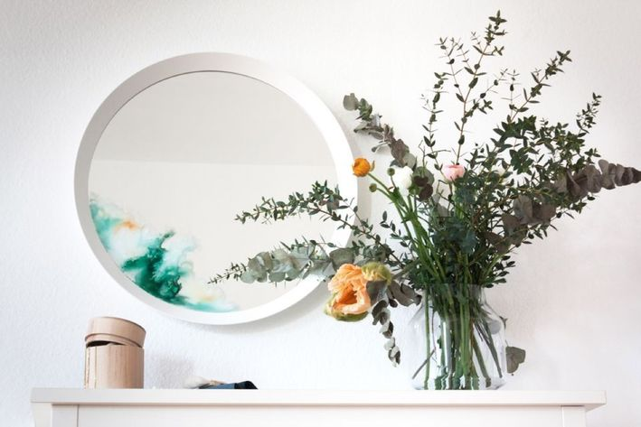 a usual IKEA mirror hack with watered down glass paint to give it a fresh and edgy feel