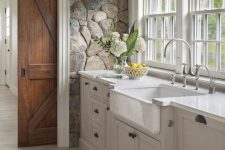 a cozy farmhouse kitchen design with natural stones on a wall