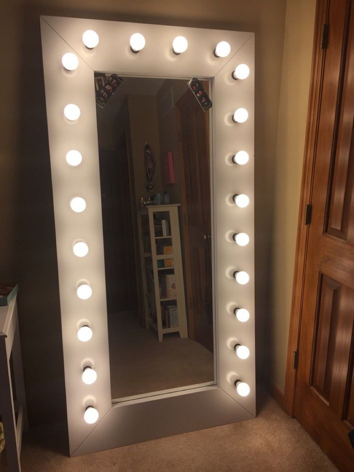 add lights along the frame to an IKEA mirror for comfortable makeup and dressing up in front of it