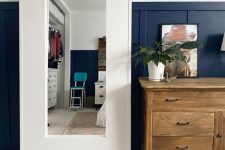 an IKEA Mongstad mirror given a large white wide frame to make it look more modern and more statement-like