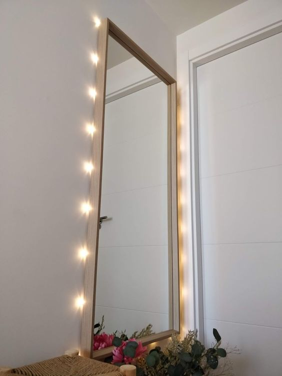 an IKEA Nissedal mirror hacked with lights will be ideal for your entryway or for your vanity nook
