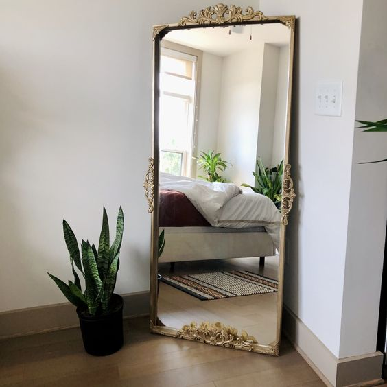 an IKEA Nissedal mirror transformed into a beautiful vintage-looking masterpiece that will bring a refined feel anywhere