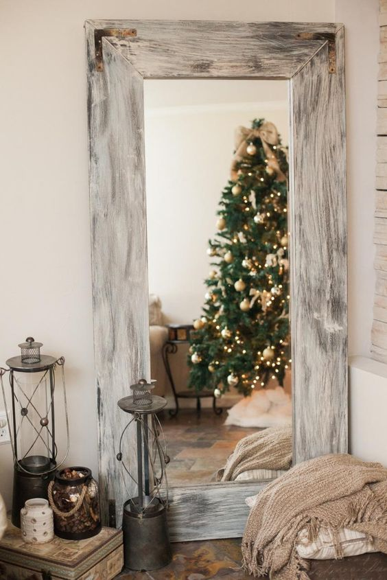 an IKEA mirror featuring a whitewashed shabby frame of wood looks very farmhouse and very cozy