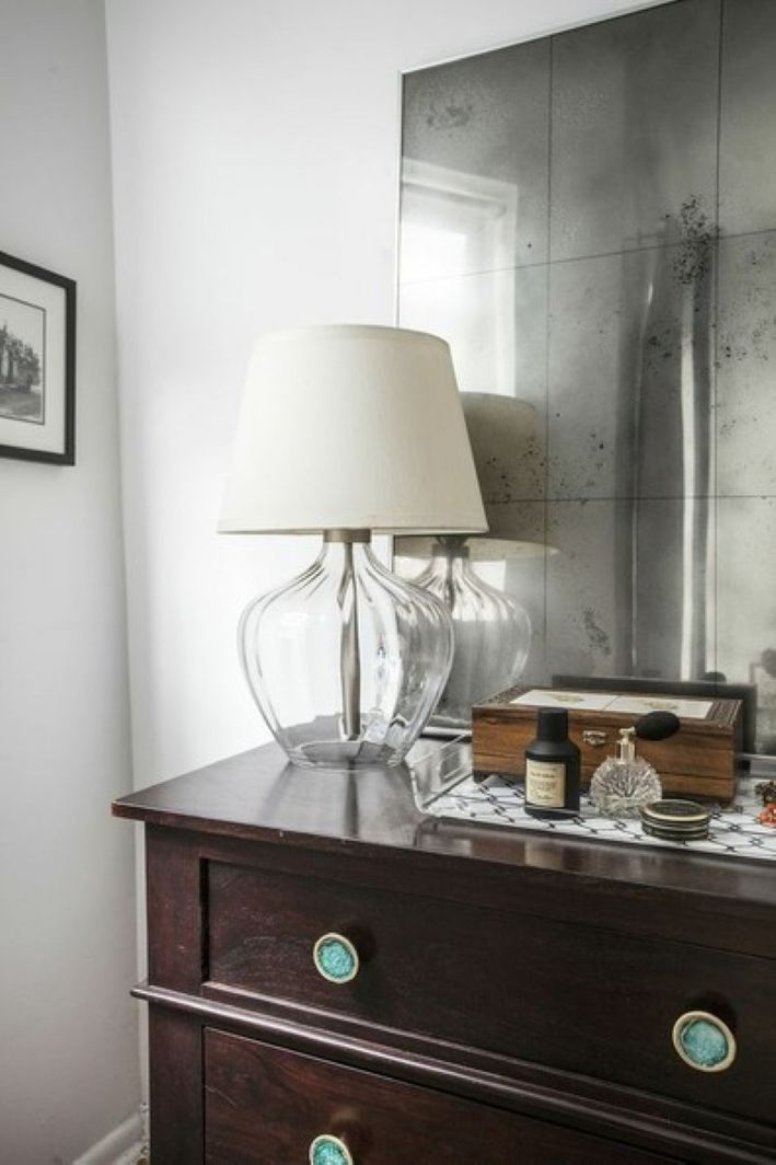 an antique-looking mirror is a simple IKEA hack that won't break the bank at all