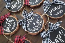 chalkboard wood slice Christmas ornaments with bright plaid bows are ideal for decorating your home for Christmas