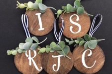 cute rustic Christmas ornaments of plywood circles, greenery and striped loops are perfect for home decor