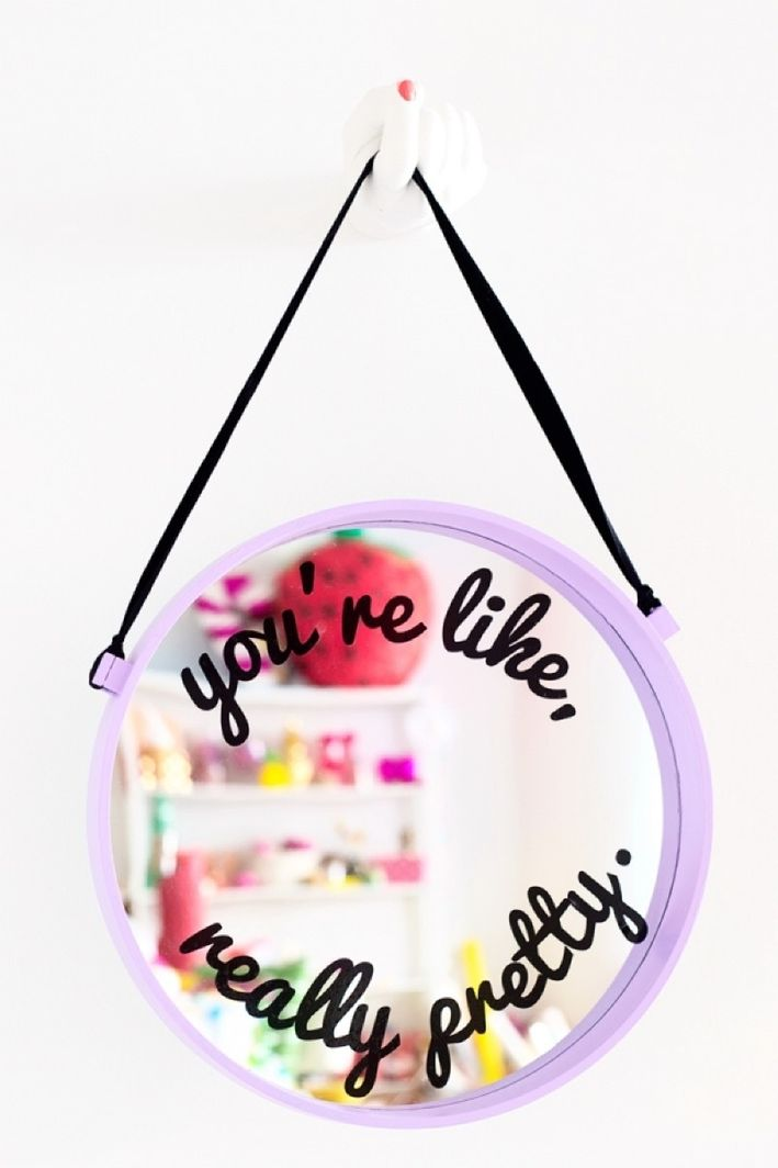 make a usual mirror bold and fresh adding pastel paint, a rope to hang it and some decals